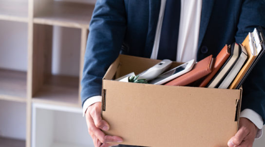Sad Fired Young Employee businessmen hold boxes including pot plant and documents for personal belongings unemployment, resigned concept